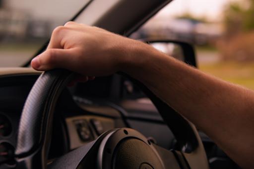 Hands on a car steering wheel